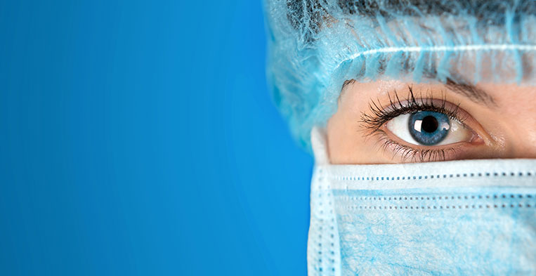 Close-up image of a nurse in surgical scrubs