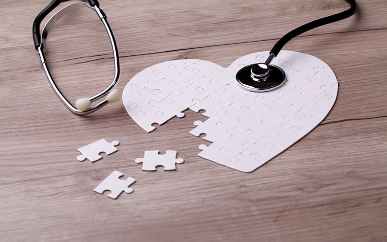 Image of a heart shaped puzzle and a stethoscope